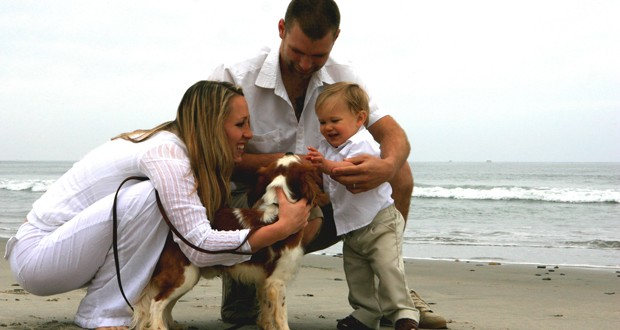 family on beach with dog 2